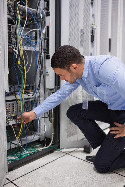 Man plugging a cable into server in data center Stock photo © wavebreak_media