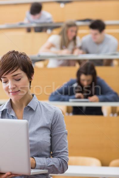 Előadó áll tart laptop előadás előcsarnok Stock fotó © wavebreak_media