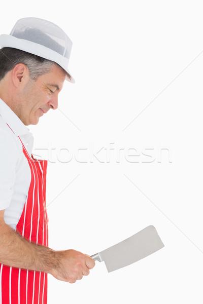 Smiling butcher wielding meat cleaver Stock photo © wavebreak_media