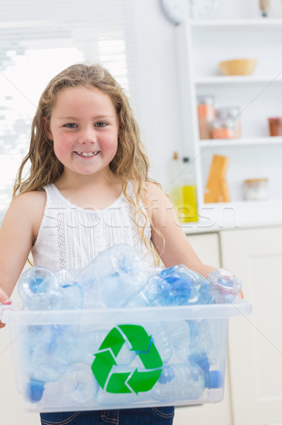 Smiling girl carrying recycling box of the plastics bottles Stock photo © wavebreak_media