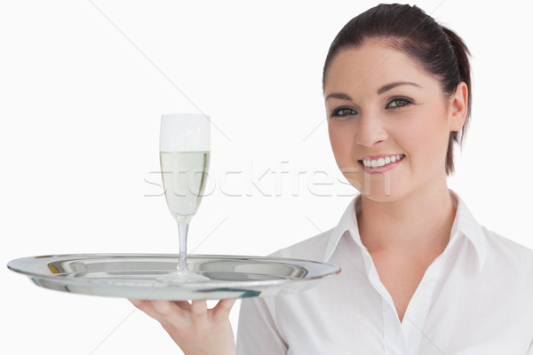 Smiling woman carrying silver tray with glass of champagne Stock photo © wavebreak_media