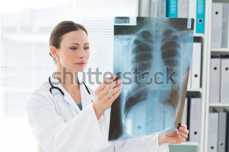 Doctor with x-ray at clinic Stock photo © wavebreak_media