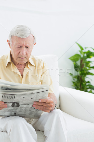 Elderly serious man reading newspapers  Stock photo © wavebreak_media
