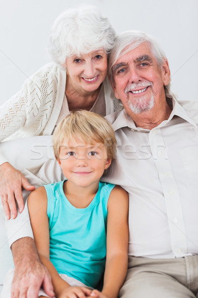 Portrait grands-parents petit-fils souriant canapé maison Photo stock © wavebreak_media
