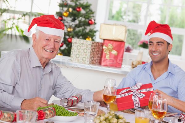 Family swapping christmas presents Stock photo © wavebreak_media