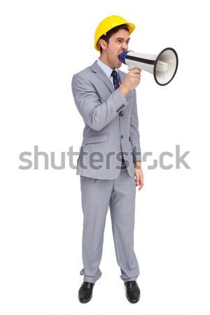 Fiatal építész kiabál megafon fehér öltöny Stock fotó © wavebreak_media