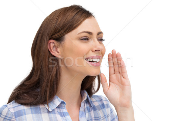 Smiling woman placing her hand to say something Stock photo © wavebreak_media