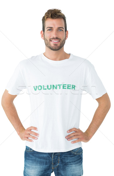 Portrait of a happy male volunteer standing with hands on hips Stock photo © wavebreak_media