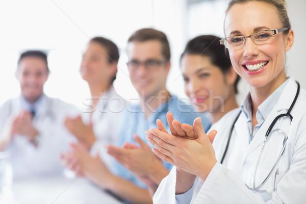 Boldog orvos csapat tapsol portré női Stock fotó © wavebreak_media