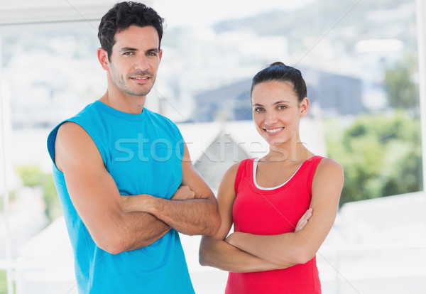 Fit couple with arms crossed in bright exercise room Stock photo © wavebreak_media