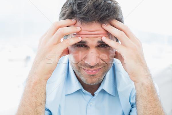Aantrekkelijk man vergadering bank hoofdpijn naar Stockfoto © wavebreak_media