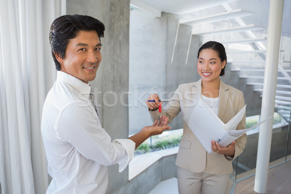 Estate agent giving house key to buyer Stock photo © wavebreak_media