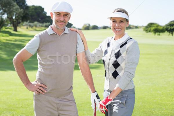 Golfozás pár mosolyog kamera tart napos idő Stock fotó © wavebreak_media