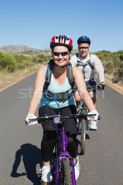 Fit smiling couple going for a bike ride in the countryside Stock photo © wavebreak_media