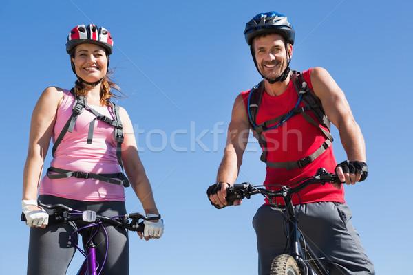 Fitt kerékpáros pár áll mosolyog kamera Stock fotó © wavebreak_media