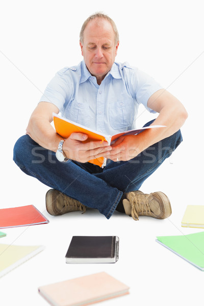 Mature student studying from notebook Stock photo © wavebreak_media