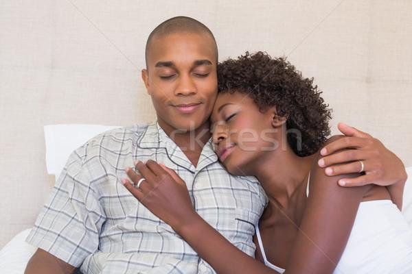 Boldog pár ül ágy ölelkezés otthon Stock fotó © wavebreak_media