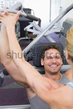 Shirtless muscular man lifting barbell in gym Stock photo © wavebreak_media