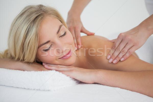 Pretty blonde enjoying a massage Stock photo © wavebreak_media