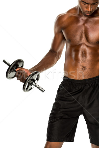 Mid section of fit shirtless young man lifting dumbbell Stock photo © wavebreak_media