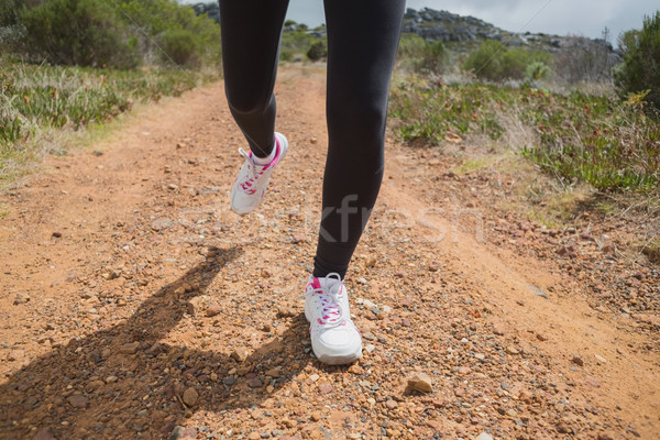 Low section of woman running on country road Stock photo © wavebreak_media