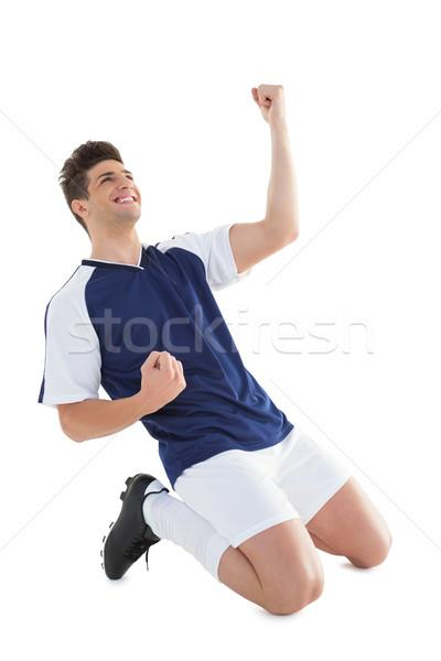 Atletisch voetballer juichen witte voetbal Blauw Stockfoto © wavebreak_media