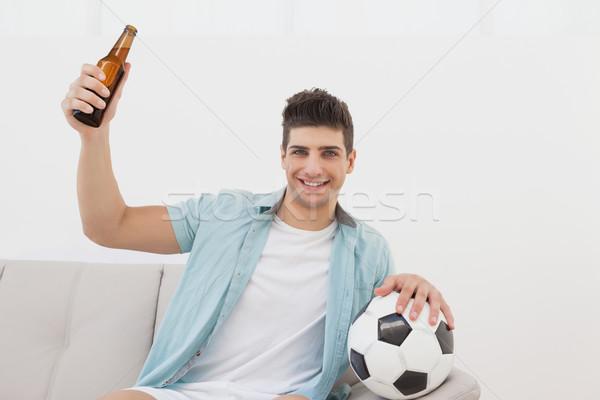 Soccer fan cheering while watching tv Stock photo © wavebreak_media
