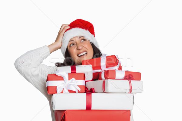 Shocked woman with christmas presents Stock photo © wavebreak_media