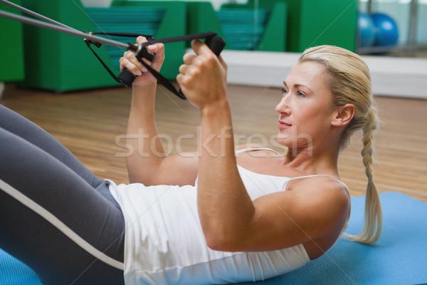 Vista lateral mujer resistencia banda fitness estudio Foto stock © wavebreak_media