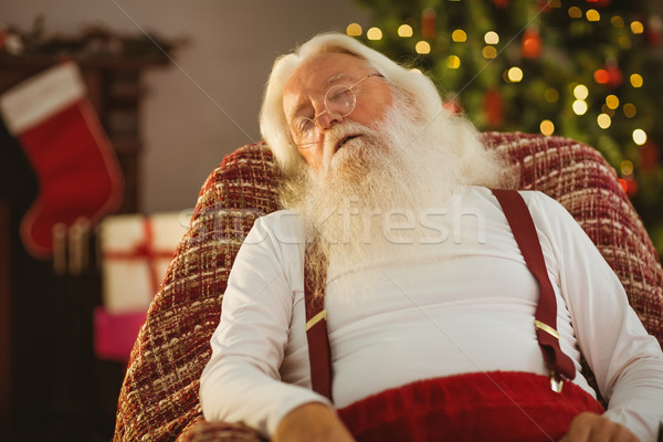 Santa claus sleeping on the armchair Stock photo © wavebreak_media