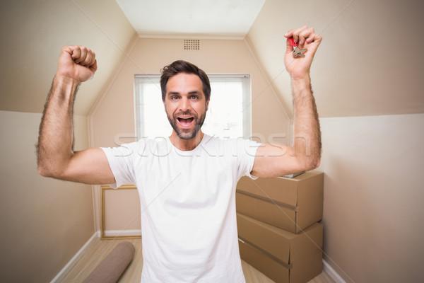 Lezser férfi mutat ház kulcs új otthon Stock fotó © wavebreak_media