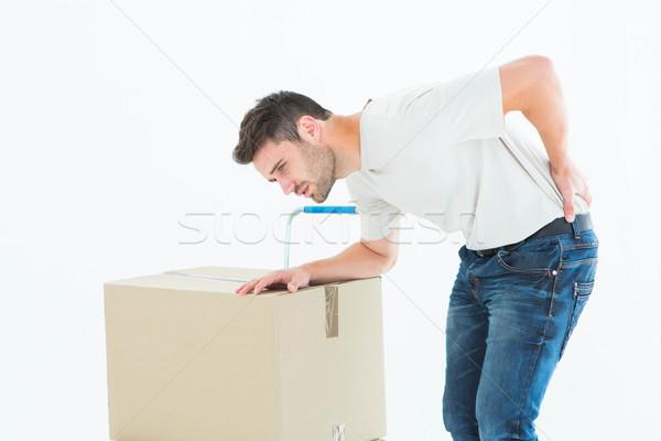 Delivery man with cardboard box suffering from backache Stock photo © wavebreak_media