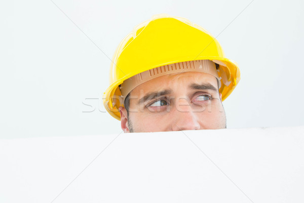 Repairman looking away while in front of billboard Stock photo © wavebreak_media