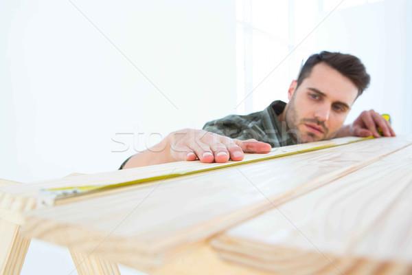 Munkás mér fából készült palánk férfi építőmunkás Stock fotó © wavebreak_media