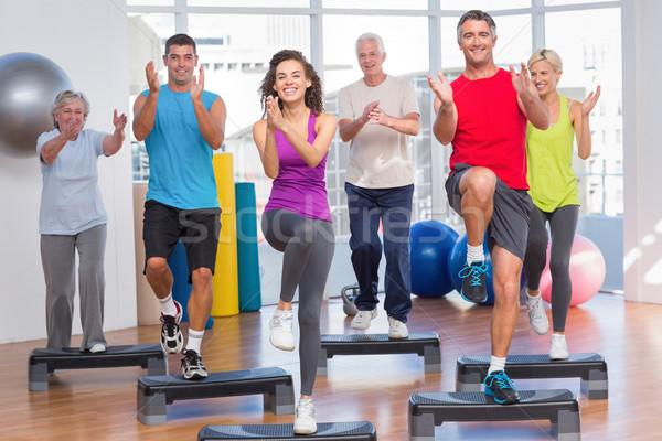 Mensen stap aerobics oefening gymnasium Stockfoto © wavebreak_media