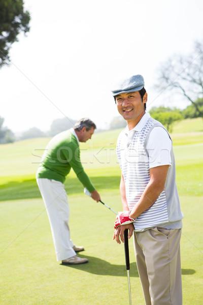 Gra w golfa znajomych zielone golf szczęśliwy sportu Zdjęcia stock © wavebreak_media