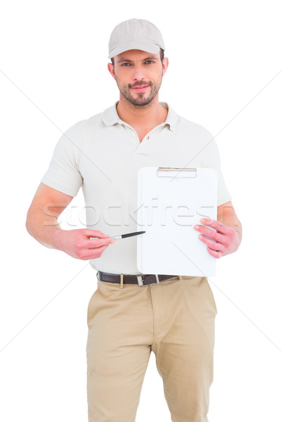 Delivery man giving clipboard for signature Stock photo © wavebreak_media