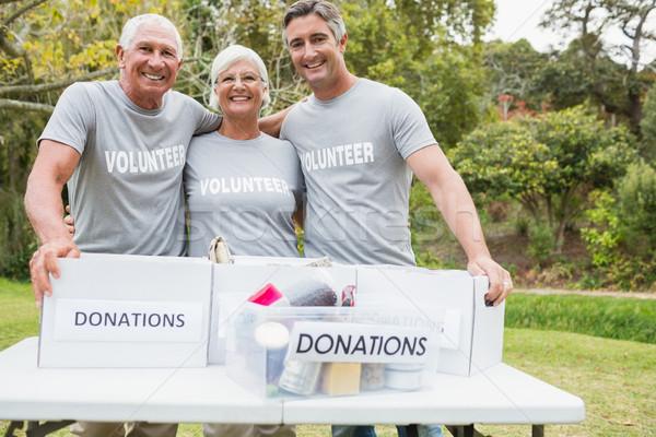 Happy family volunteer smiling at camera  Stock photo © wavebreak_media