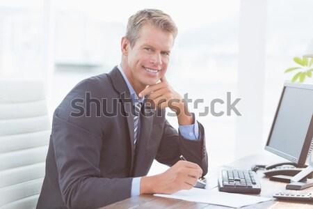 Happy businessman looking at the camera Stock photo © wavebreak_media