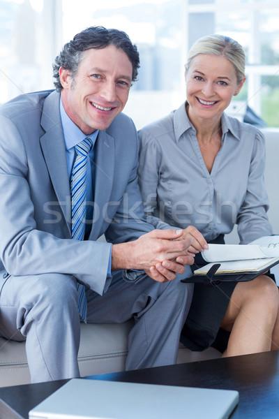 Lächelnd Geschäftsmann Sekretär schauen Tagebuch Wohnzimmer Stock foto © wavebreak_media
