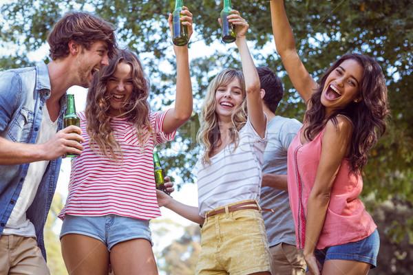 Boldog barátok park napos idő férfi nap Stock fotó © wavebreak_media