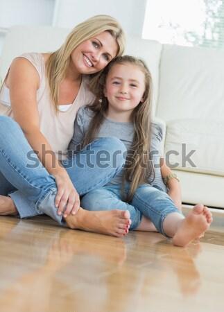 Stock photo: Young couple sitting on floor