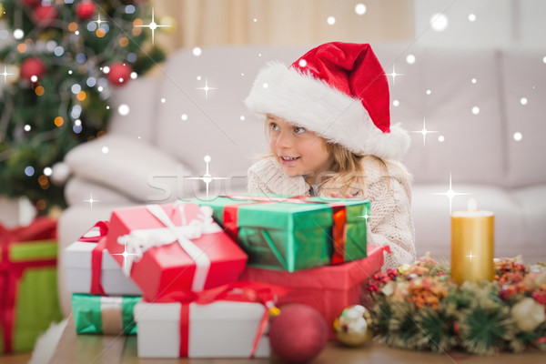 Composite image of cute little girl surrounded by christmas gift Stock photo © wavebreak_media