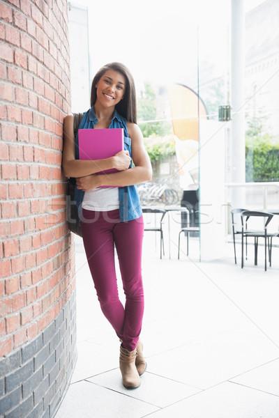 Dość student uśmiechnięty ściany edukacji Zdjęcia stock © wavebreak_media