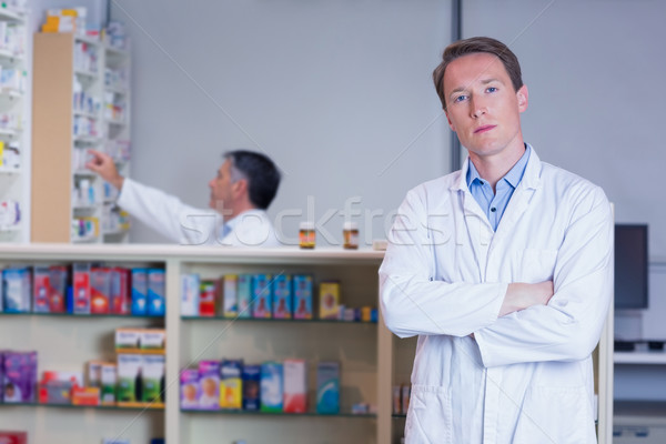 Unsmiling pharmacist standing with arms crossed Stock photo © wavebreak_media