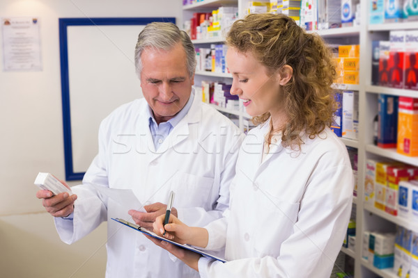 Pharmacists looking a medication for a prescription Stock photo © wavebreak_media