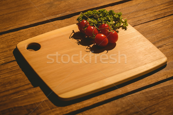 Pomodorini prezzemolo tagliere copia spazio cucina cottura Foto d'archivio © wavebreak_media