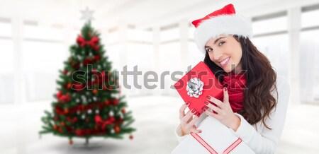 Composite image of happy brown hair opening gift  Stock photo © wavebreak_media