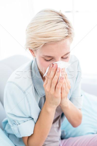 Ziek blonde vrouw blazen neus woonkamer huis sofa Stockfoto © wavebreak_media