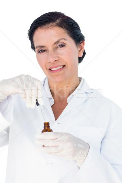 Confident female doctor holding medicine bottle Stock photo © wavebreak_media